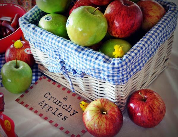 apples in a gingham wicker basket