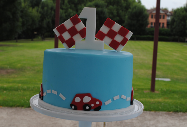 red and blue car first birthday cake Mon Tresor