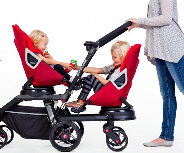 woman pushing two children in Orbit Helix pram in red