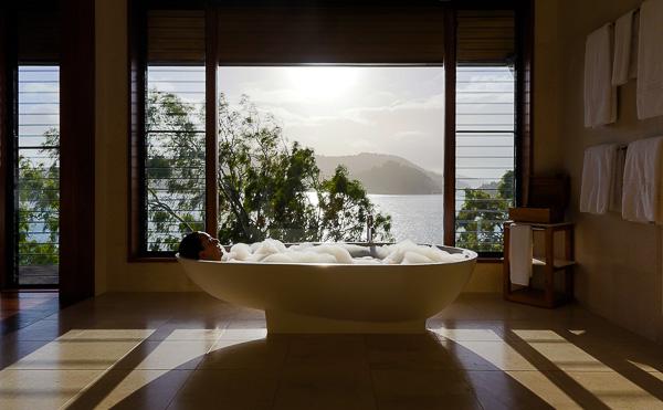 Woman in bathtub at resort