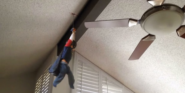 action movie kid hanging from ceiling