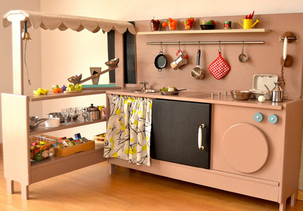 world of dream wooden kitchen and role play toys at Macarena Bilbao