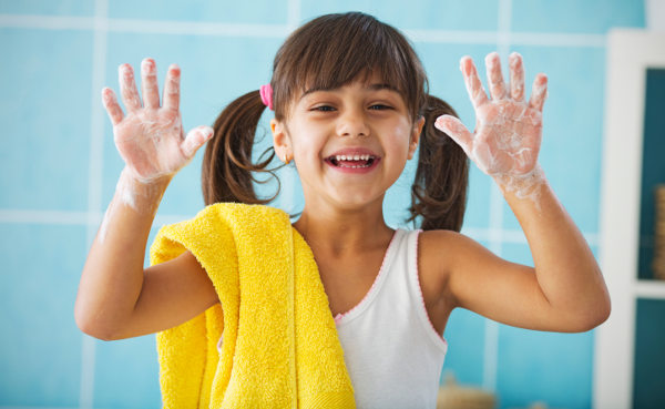 Child washing hands with regular soap