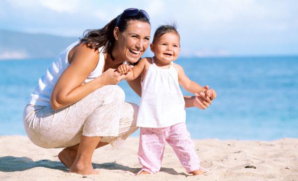 Australian mum on beach with baby
