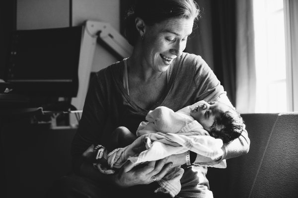 woman holding new baby Blended project Kate T Parker