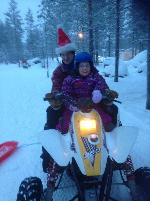 Evie Kean outside in snow on snowmobile
