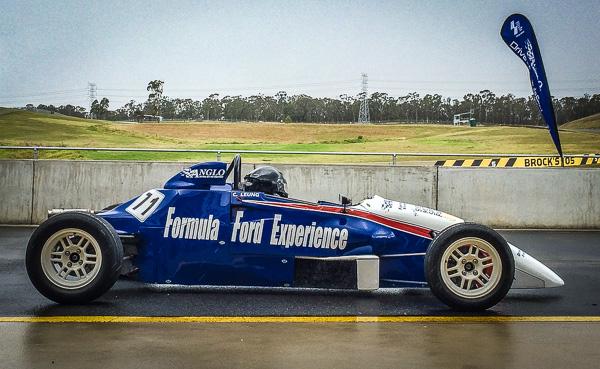 Formula Ford racing car sits in the pits at Eastern Creek