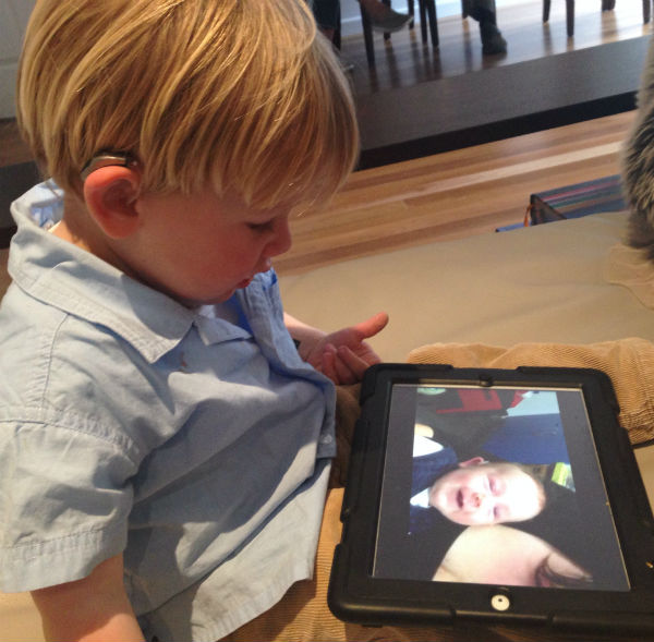 Lachlan Lever looking at ipad