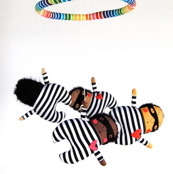 pinkcheeks2, burglar baby mobile