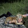 Animal attraction – photographer captures bond between daughter and animals