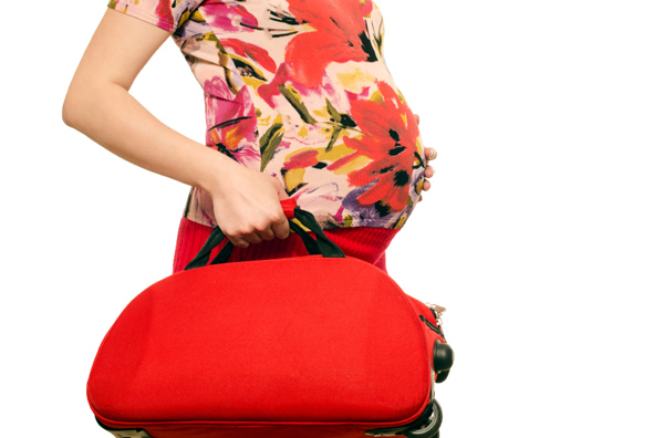 pregnant-woman-with-bag