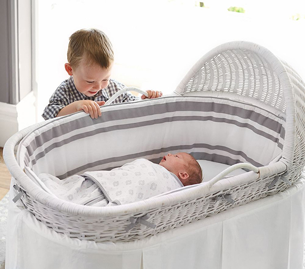 Pottery Barn Kids Bassinet with boy and baby