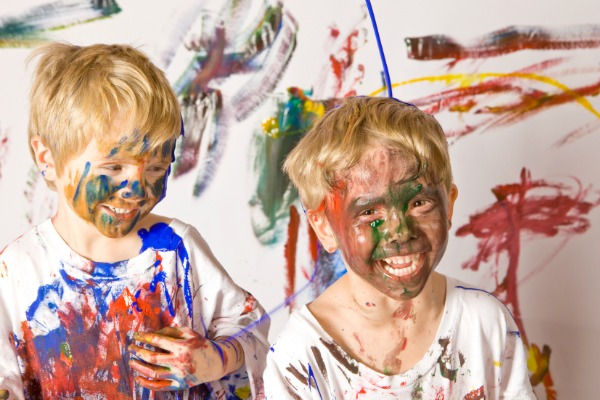 boys covered in coloured paint