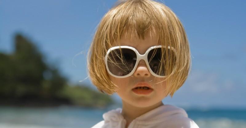 cute young girl wearing big sunglasses