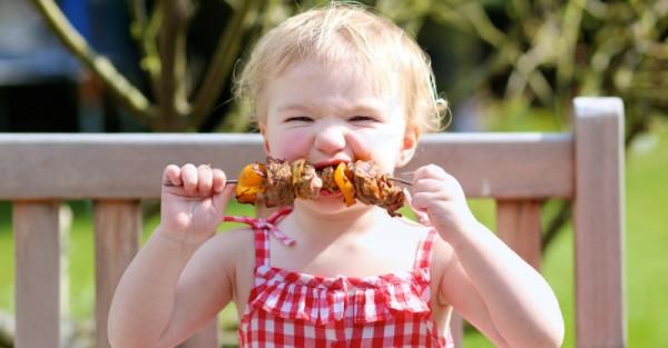 amart child eating outdoors