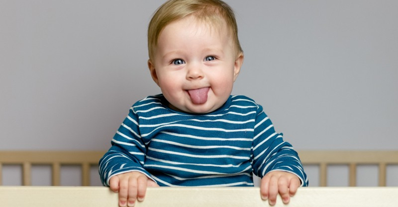 cute baby standing in cot