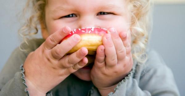 child eating junk food health donut