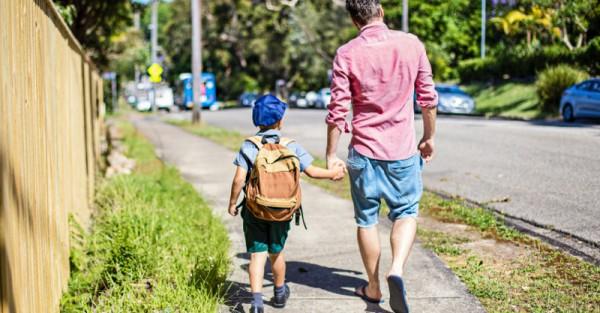 school dad walking uniform backpack