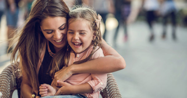 Happy mother and daughter laughing together