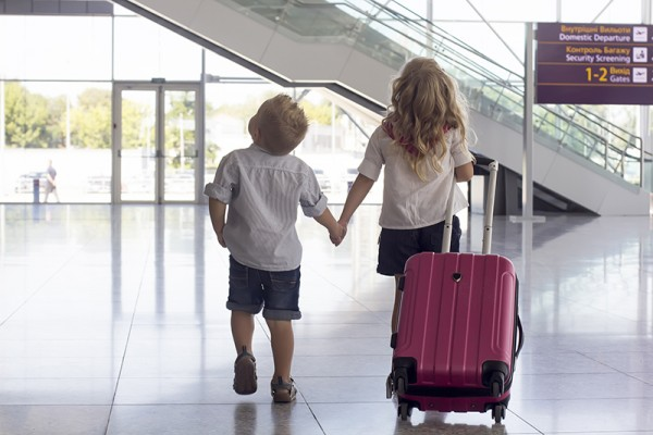 girl n boy at the airport with a suitcase; Shutterstock ID 164637131; PO: 1034194; Job: MPOS1455; Client: Australia Post; License to Y&R Group?: Yes