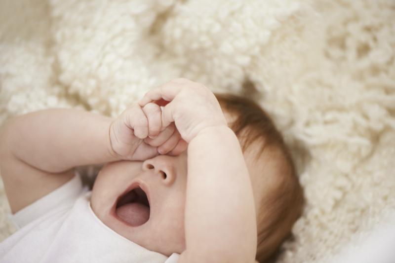 baby sleep tired stock sl