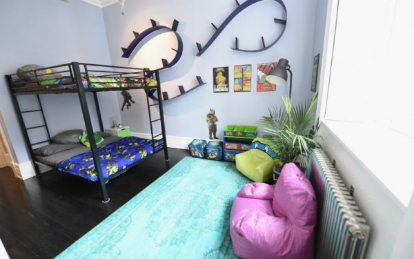 Little ones will love the cosy bunk beds, decked out with turtle doonas,  pillows and furnishings. - Lounge In Luxury At This Teenage Mutant Ninja Turtle Themed Lair