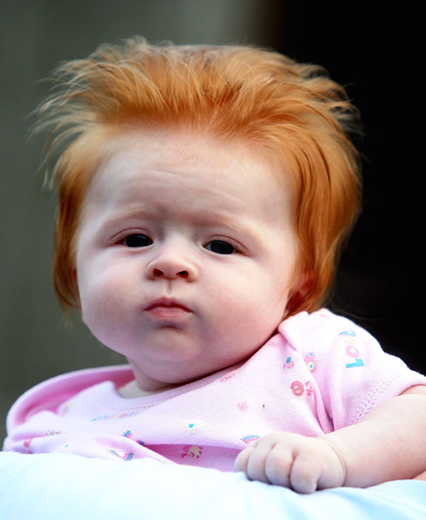 young baby with lots of red hair