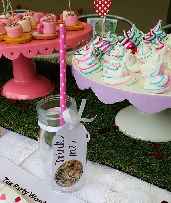 Belle's Alice in Wonderland party drink me