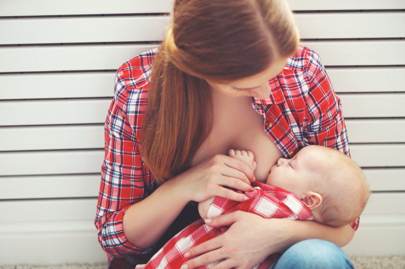 breastfeeding. mother breast feeding her baby toddler