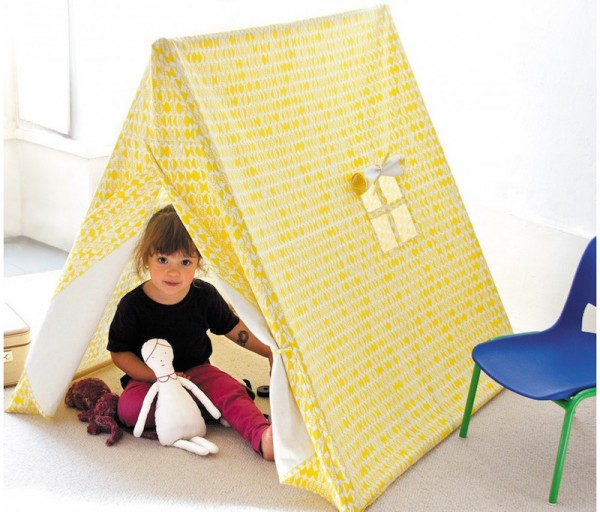 kid in yellow tent