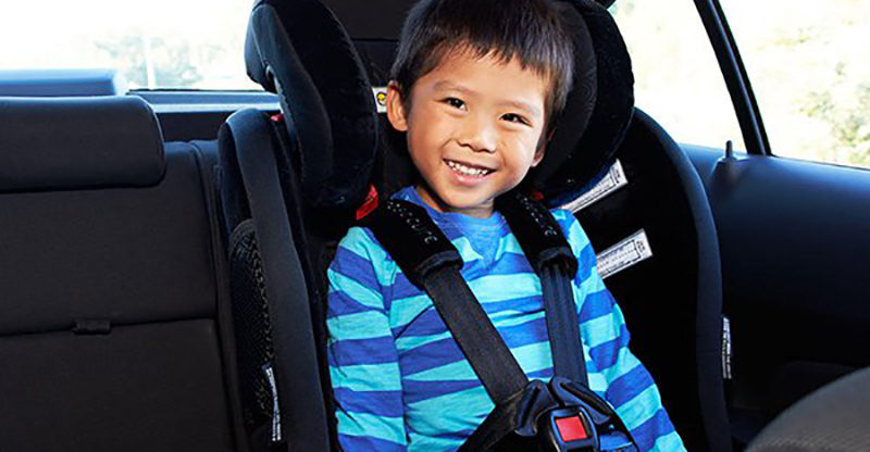 Boy sitting in carseat