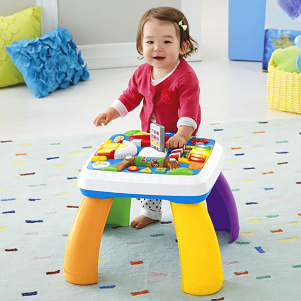 Baby playing with Fisher Price Laugh and Learn table