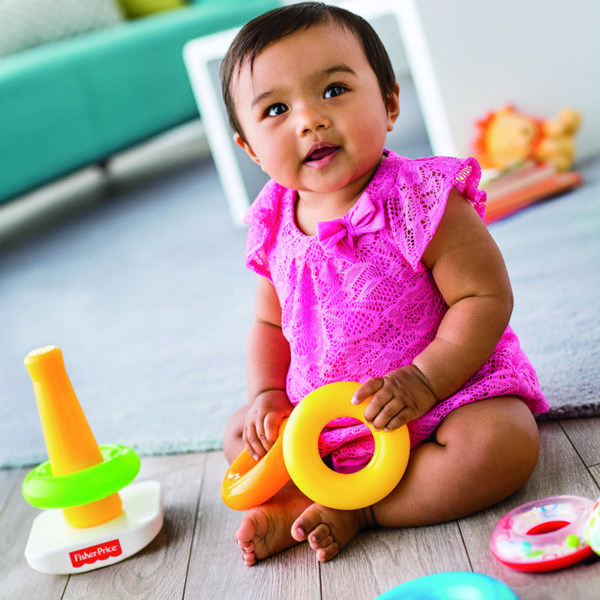 Baby playing with Fisher Price Rock A Stack
