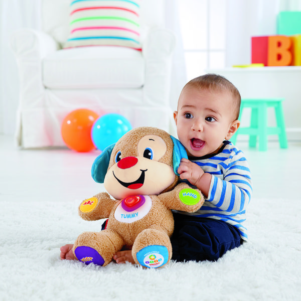 Baby playing with Smart Stage Puppy from Fisher Price
