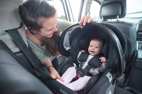 rear-facing car seat mum baby