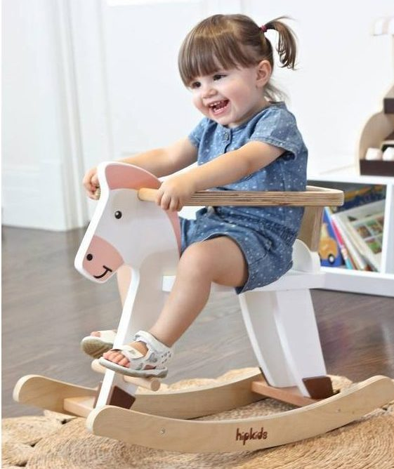 little girl on rocking horse