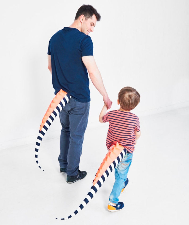 Parent and kid matching dinosaur tails