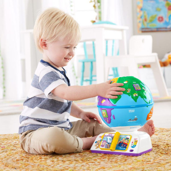 Toddler playing with Fisher Price globe