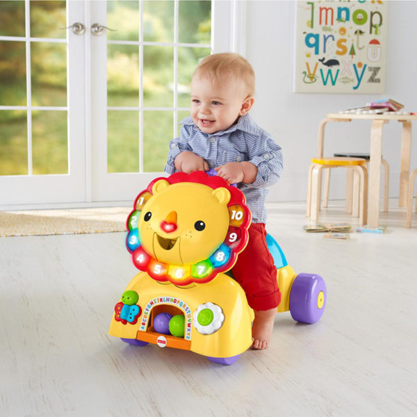 Baby playing with Fisher Price 3-in-1 Sit, Stride & Ride Lion