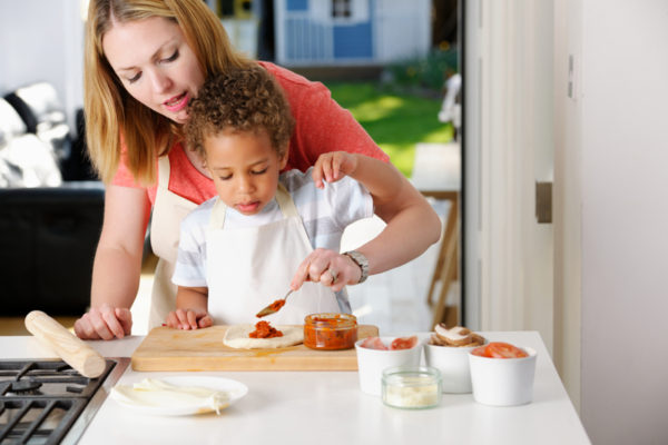 professional-nanny-with-child-cooking-sl