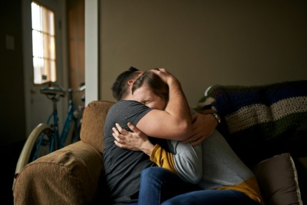Couple hugging and crying