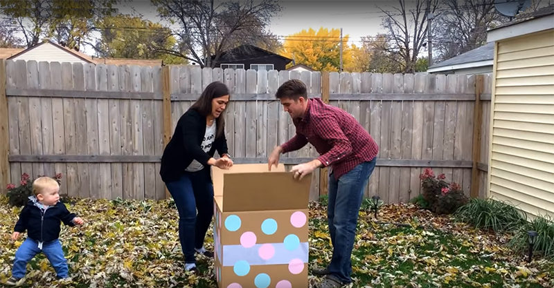 Pregnant woman and husband look into spotted box