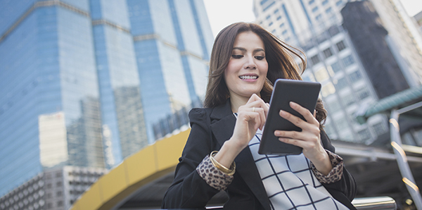 Chic Business woman on tablet