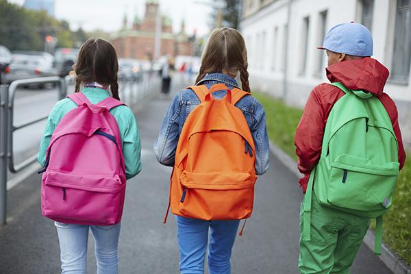 three kids walking