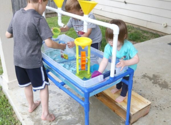Water play with pipes and funnels