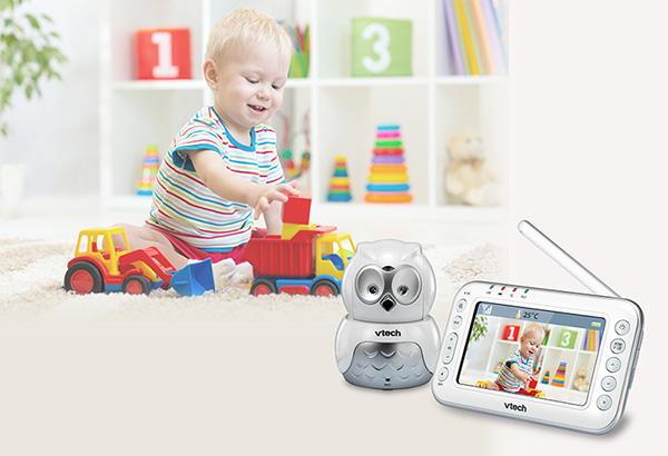 toddler playing next to baby monitor