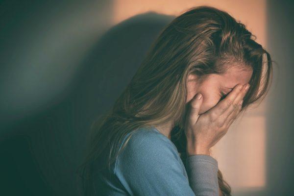 sad woman with postnatal depression