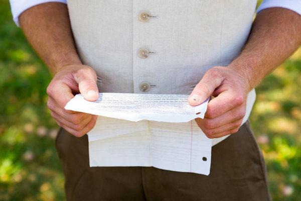 Man reading wedding vows