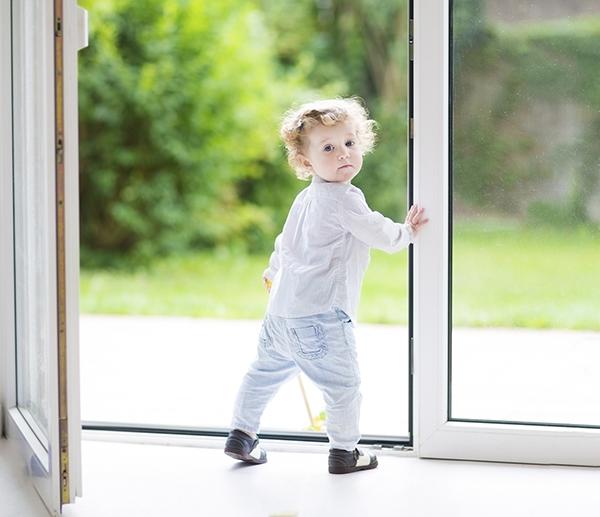baby standing in door