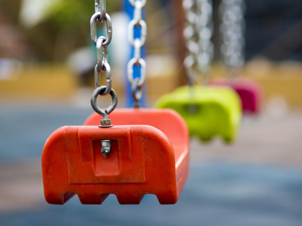 Close up of empty swing in a playground